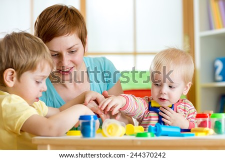 kids and woman play colorful clay toy indoor - stock photo