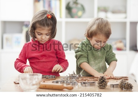 Kids are making cookies - stock photo