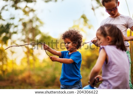 Kids are playing in nature - stock photo