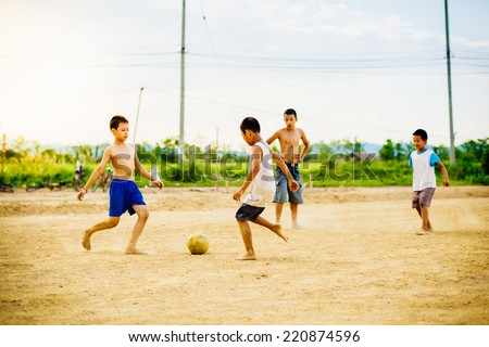 kids are playing soccer football. - stock photo