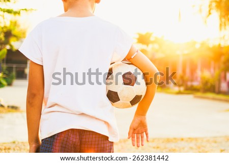 kids are playing soccer football for exercise under the sunlight. - stock photo