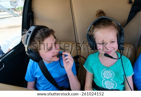 Kids at cabin of helicopter before scenic flight - stock photo