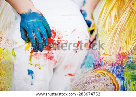 kids backside painted in bright colors - stock photo
