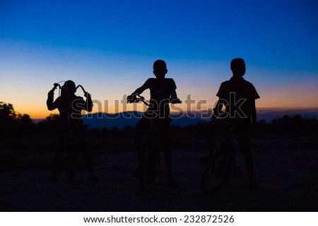 kids bicycle in the evening - stock photo