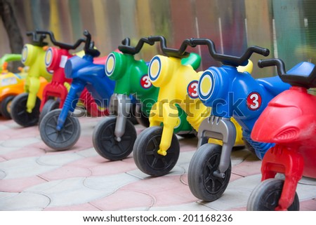 Kids bicycles stringed in a row - stock photo