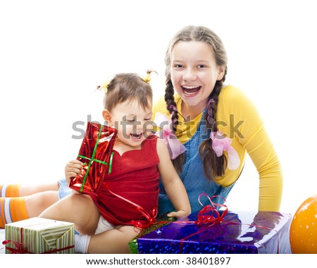 Kids birthday - toddler and teenager girls sit with present,isolated on white - stock photo