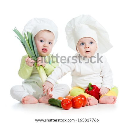 kids boy and girl wearing a chef hat with healthy  food vegetables - stock photo