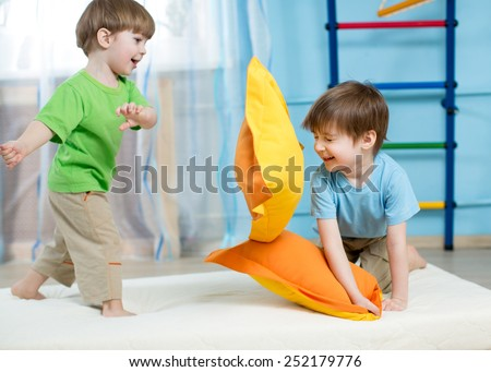 kids boys have fun playing with pillows at home - stock photo