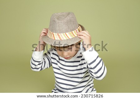 Kids, children clothing and fashion. Happy boy with a fedora hat, posing and having fun - stock photo