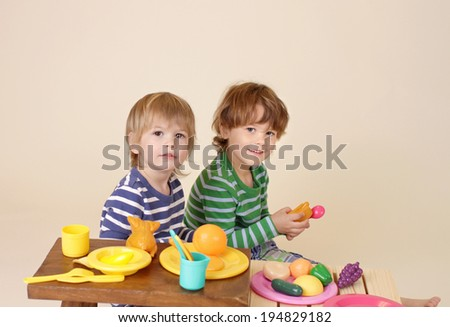 Kids, children cooking and playing with pretend food, sharing and nutrition concept - stock photo