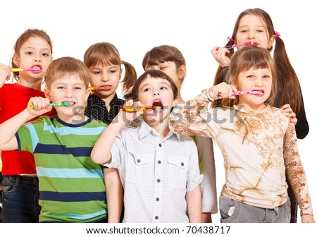 Kids crowd cleaning teeth, over white - stock photo