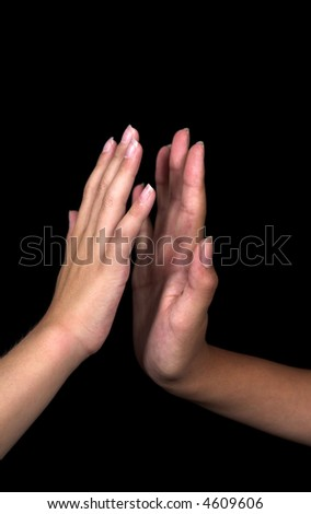 kids doing hand signs over black background