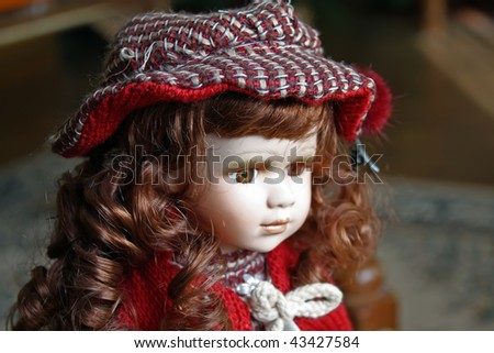 kids doll. miniature model of a girl. ceramic girl toy. - stock photo