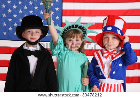 Kids dressed up in patriotic costumes - stock photo