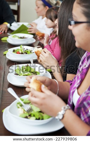 kids eating healthy / it's nice to see in these days / of the junky foods - stock photo