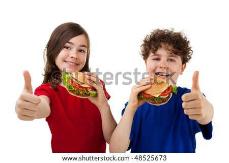 Kids eating sandwiches showing thumbs up isolated on white background
