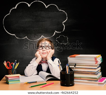 Kids Education, Child Boy Study in School, Thinking or Dreaming Bubble over Black Chalkboard