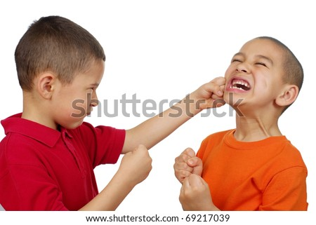 Kids fighting, seven and eight years old - stock photo