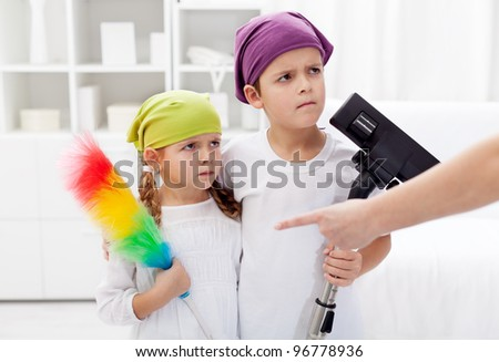 Kids forced to clean their room, parent hand pointing - stock photo