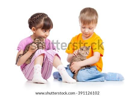 Kids girl and boy stroke kittens - stock photo