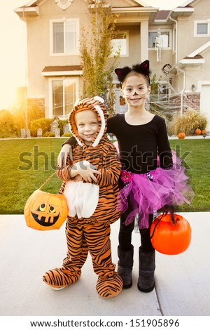 Kids Going Trick or Treating on Halloween - stock photo