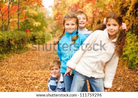 Kids group in autumn park - stock photo