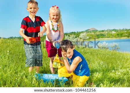 Kids group playing with water - stock photo