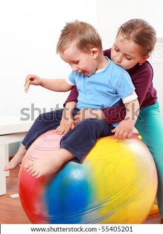 Kids have a fun with the gymnastic ball - stock photo