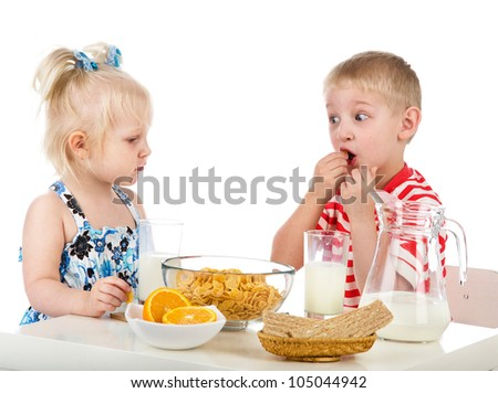 Kids having a healthy breakfast. isolated on white background - stock photo
