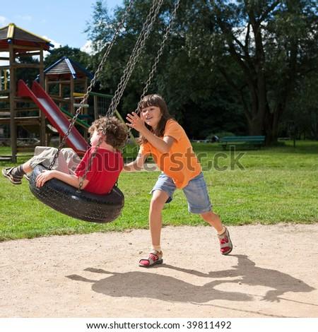 Kids having fun in park - stock photo
