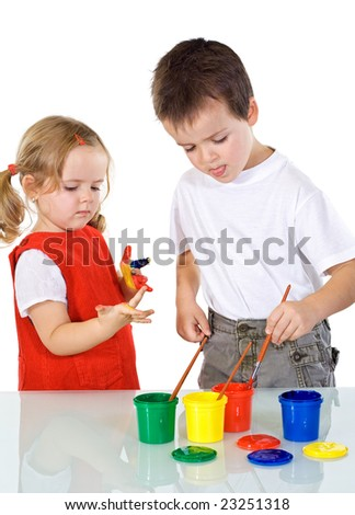 Kids having some fun with different color paints - isolated