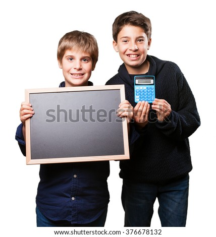 kids holding a blackboard - stock photo