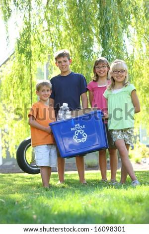 Kids holding recycle bin - stock photo