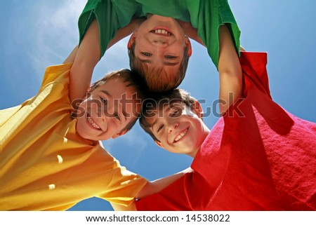 Kids Huddling on a Beautiful Day - stock photo