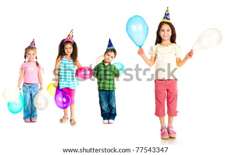 Kids in birthday caps isolated on white