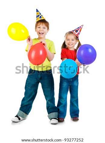 Kids in birthday caps  on white background
