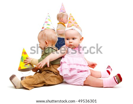 Kids in party hats, isolated, over white - stock photo