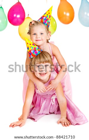 Kids in party hats playing - stock photo