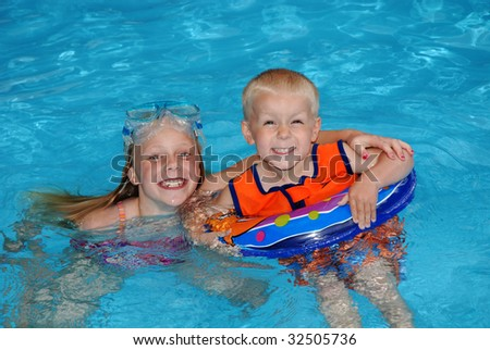 kids in pool - stock photo