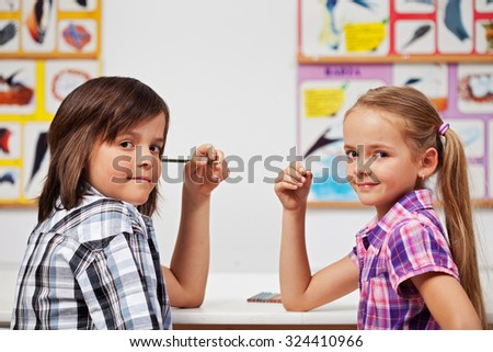 Kids in science class looking back and smiling - copy space - stock photo