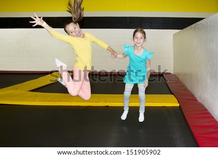 Kids Jumping on Indoor Trampolines - stock photo