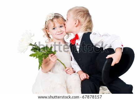 kids kissing isolated on white background old fashioned look over white - stock photo