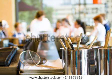 Kids learning how to cook in cooking school. - stock photo