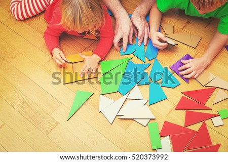 kids learning -little boy and girl playing with geometric shapes
