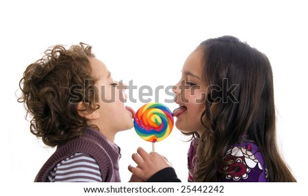 kids licking a lollipop on a white background - stock photo