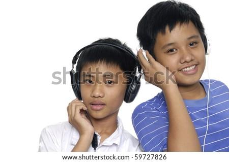 Kids listening to music - stock photo