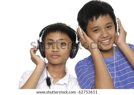 Kids listening to music-close up - stock photo