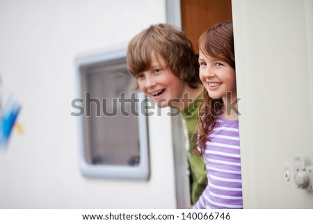 Kids Looking Away At Caravan Entrance - stock photo