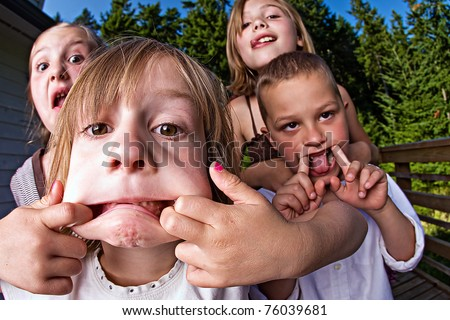 Kids making silly faces - stock photo