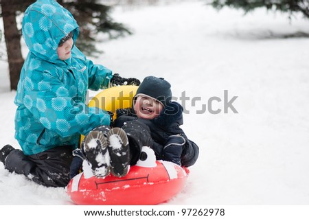 Kids on a walk in the park in winter